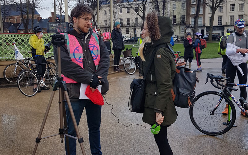 patrick being interviewed at the mass cycle